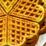 Stacked pandan waffles on a plate