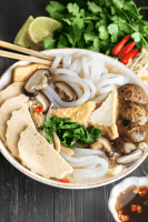 Banh canh chay in a bowl with chopsticks in the bowl