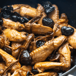 Braised wings, mushrooms and dried lily flowers in a wok