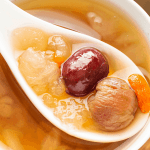 Hashima Dessert Soup in a bowl with a spoon scooping it up