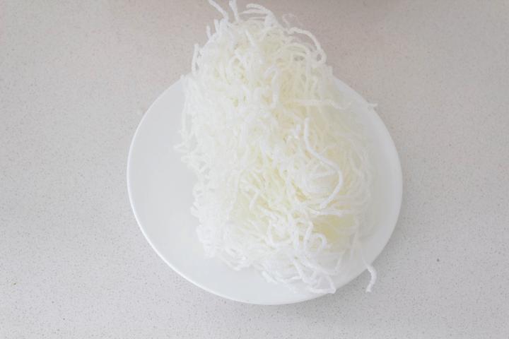 Fried green bean thread on a plate.