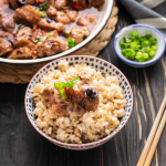 Steamed Pork Ribs in a bowl of rice next to a dish with more ribs.