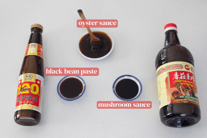 Dishes of oyster sauce, black bean paste, mushroom sauce and their corresponding bottles.