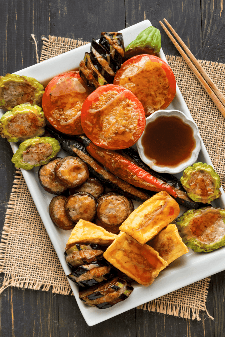 Stuffed Tofu on a plate with a dish of sauce.