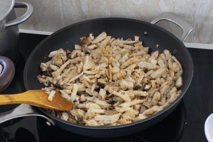Sliced mushrooms in a wok.