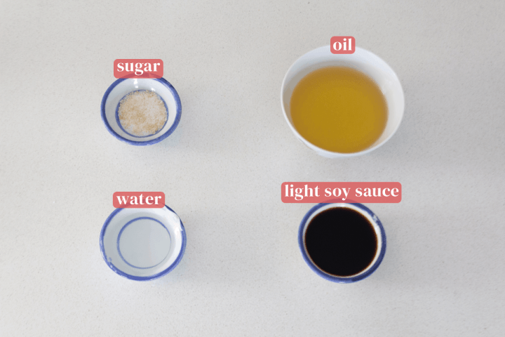 Dishes of sugar, oil, water and light soy sauce.
