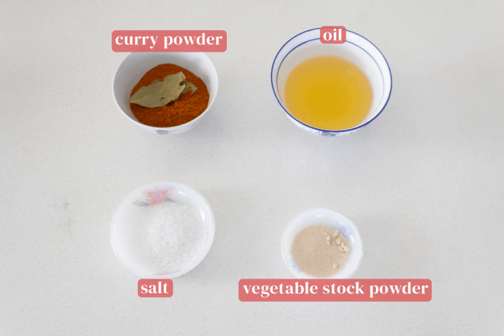 Bowls of curry powder, oil, vegetable stock powder and salt.
