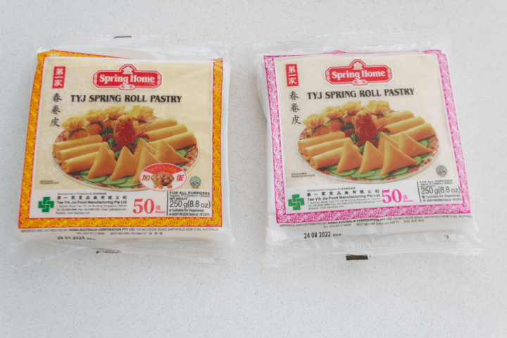 Egg and eggless spring roll wrappers in their packets.