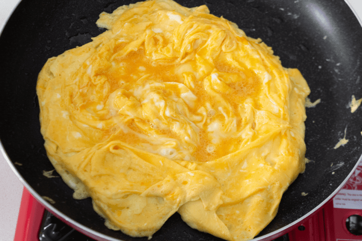 Eggs cooking in a pan.