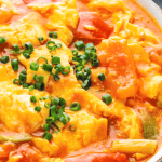 A close up of Egg and Tomato Stir Fry in a dish.