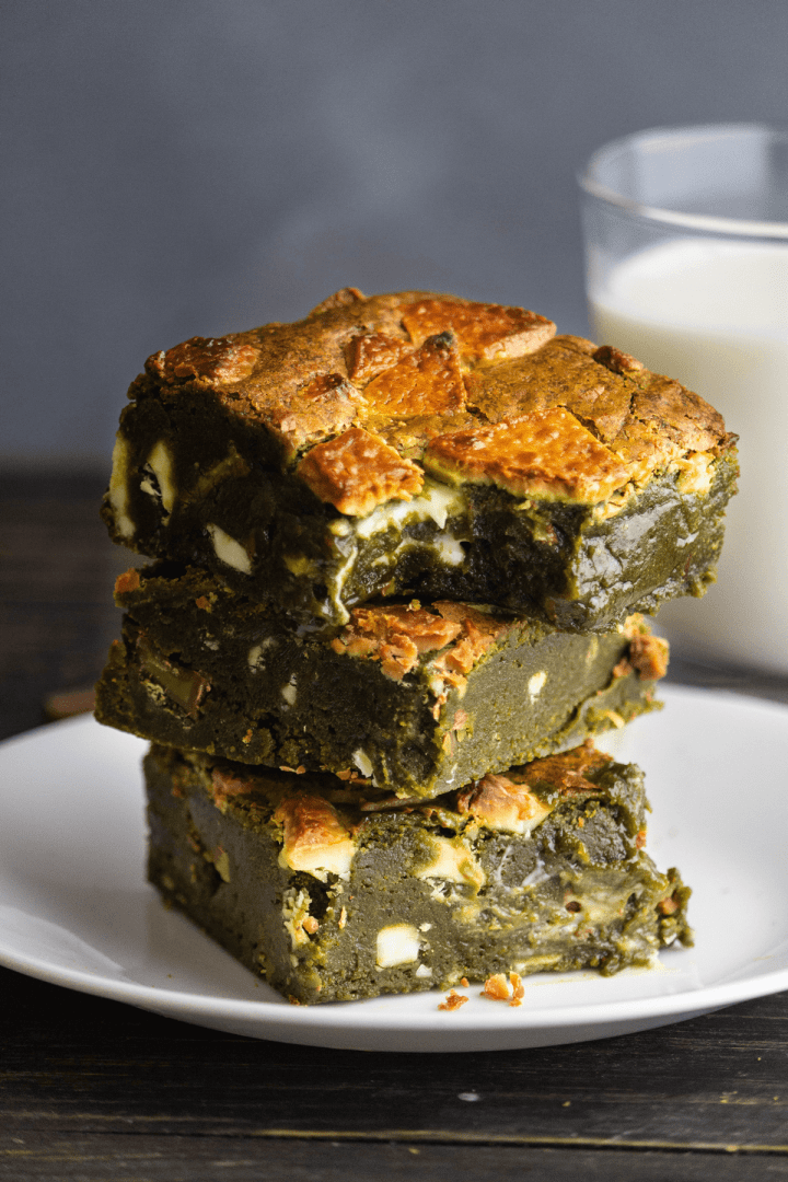 Matcha Brownies stacked on a plate.
