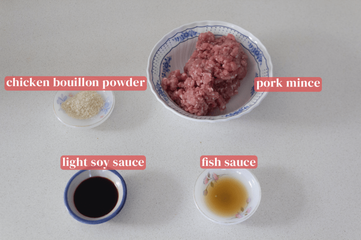 Dishes with chicken bouillon powder, fish sauce and light soy sauce along with a bowl of pork mince.