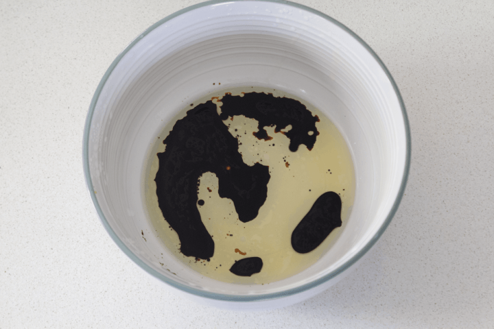 Oil and soy sauce in a bowl.