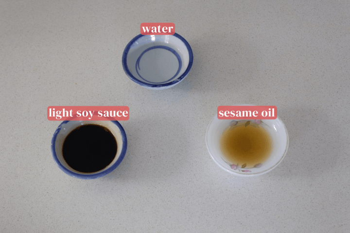 Dishes with water, light soy sauce and sesame oil.