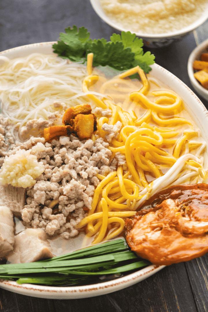 Close up of Hokkien Pork Noodle Soup in a bowl.