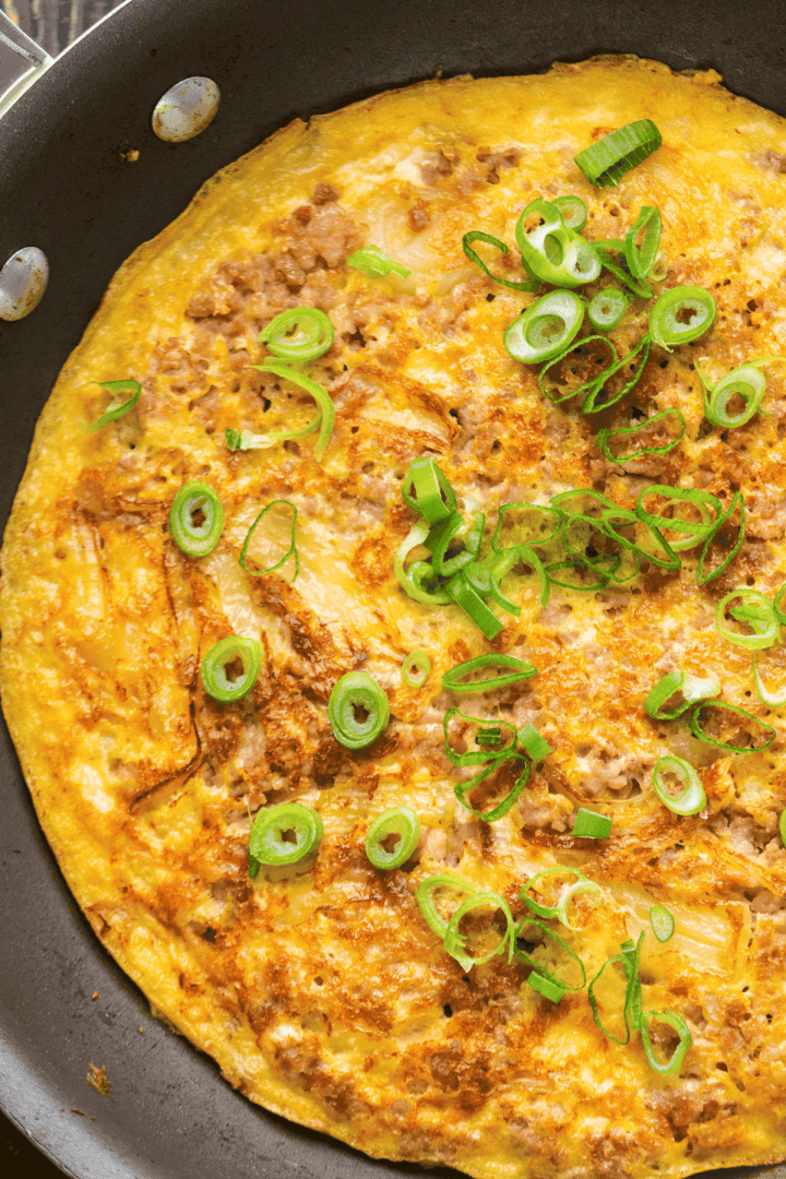 Close up of Pork Mince Omelette in a pan.