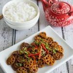 Stir Fried Lotus Root in Garlic Sauce features sliced crunchy lotus root tossed in a tangy garlic sauce. Healthy, nutritious, and incredibly delicious. Ready in only about 15 minutes!