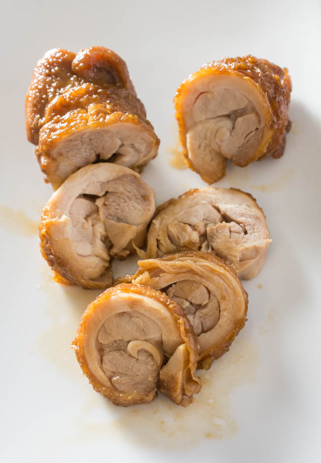 Chicken Chashu is a spin on the popular Pork Belly Chashu ramen topping. Rolled chicken thighs are pan-fried, braised in a sweet soy sauce, then left to marinade to soak in the delicious seasoning.