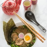 Traditional Shoyu Ramen features a savory soy-sauce based clear broth and ramen noodles with classic toppings such as chashu, seasoned bamboo shoots, and a half-boiled seasoned egg.