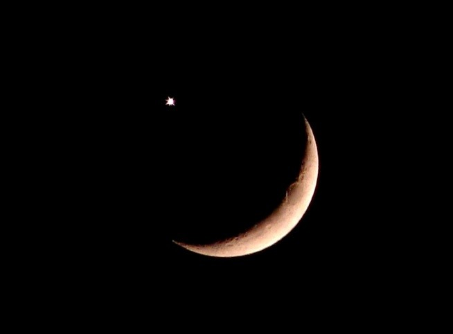 Crescent moon next to Venus.