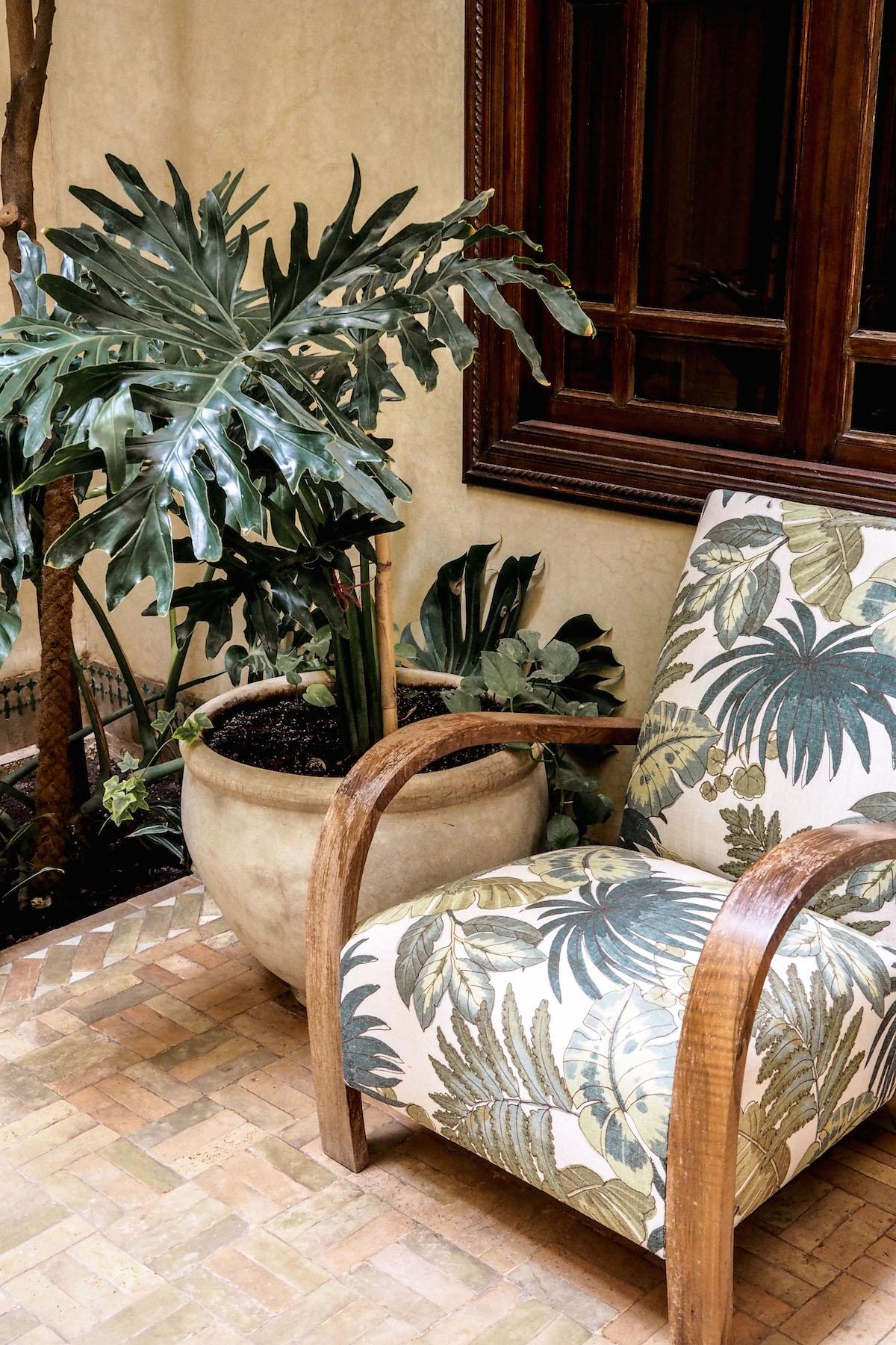Palm leaf print chair at Riad Kniza, Marrakech