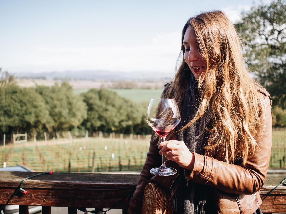 One Night in Wine Country | Wearing a brown leather jacket in Woodenhead Winery | Wolf & Stag Adventures