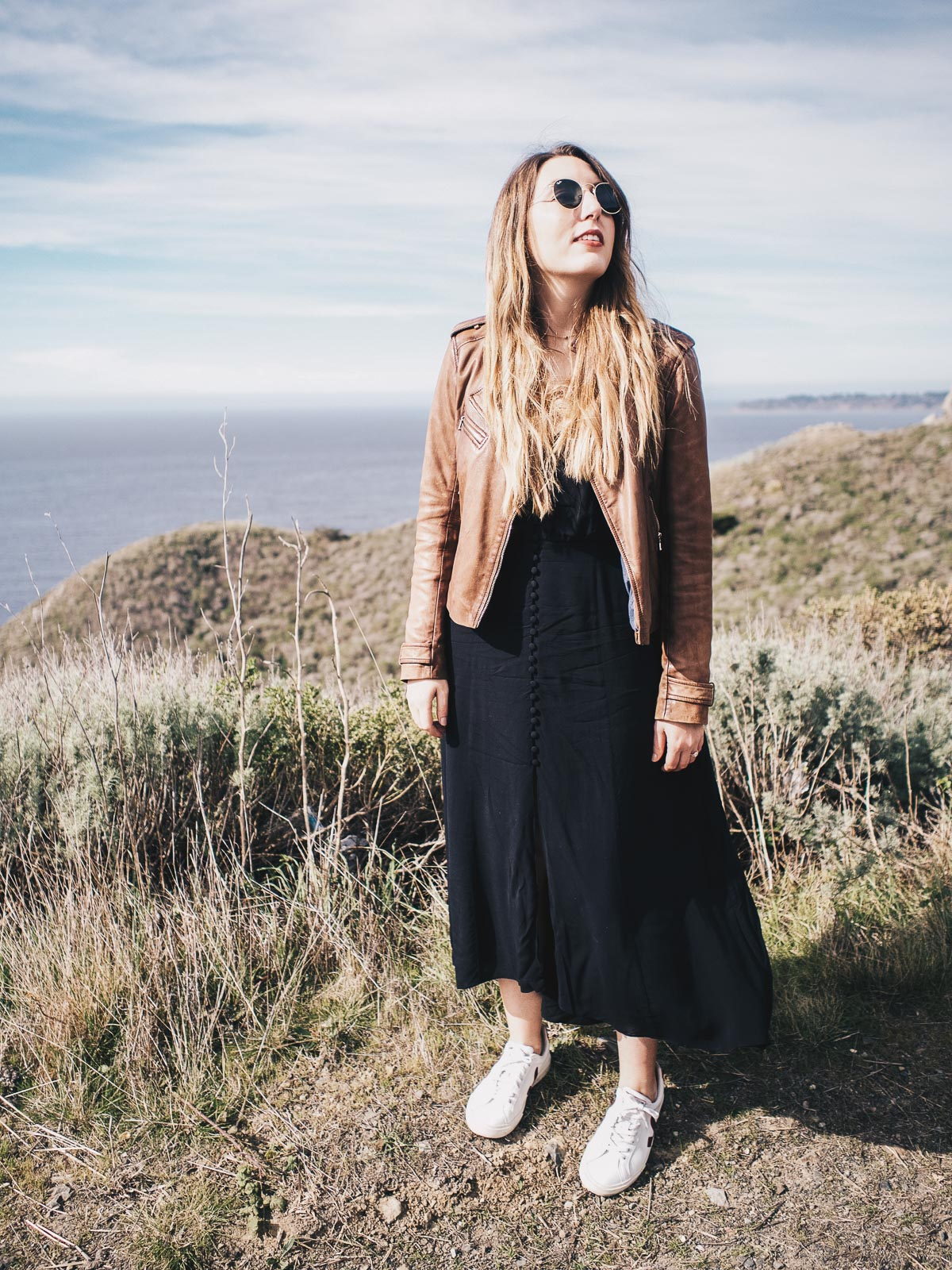 Springtime in California: featuring an Urban Outfitters black dress, Massimo Dutti brown leather jacket, Veja white sneakers and Ray-Ban sunglasses | Wolf & Stag