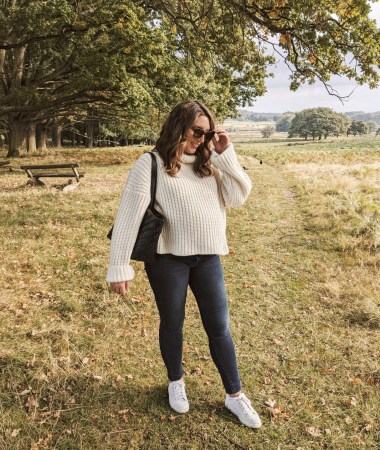 Standing in Richmond park, wearing Rodebjer cream sweater, J Brand maternity jeans, M Gemi white sneakers, and a woven black tote bag   W&S