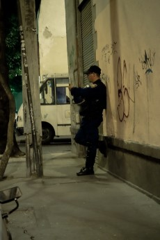 The Mexico DF Policia, holding a riot mask while texting on his phone.