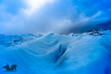 Surreal colors blue ice contrasting against grey skies.