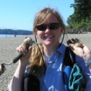 Wolf College coordinator Kim Chisholm collecting clams.