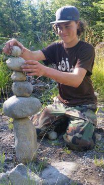 2016 Apprentice Kyler Shumaker building rock cairn at survival training.