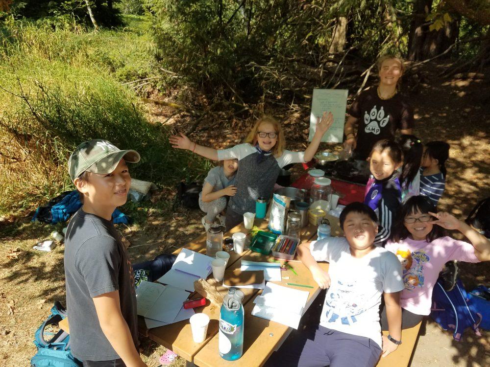 Kyler with kids journaling