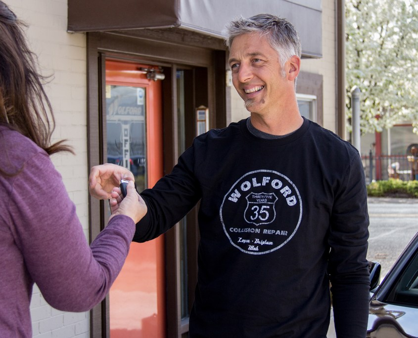 Tim Wolford Handing Off Car Keys