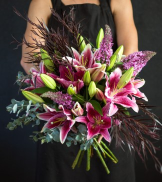 Make a statement with a bunch of fragrant oriental lilies, accompanied by mixed green foliage and a variety of seasonal blooms.
