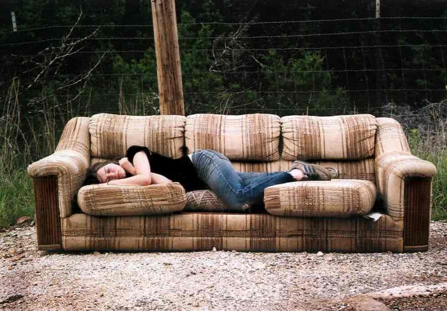 woman passed out on couch