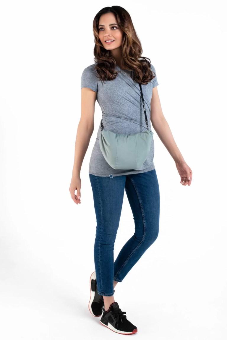 Babywearing jacket folds into a bag