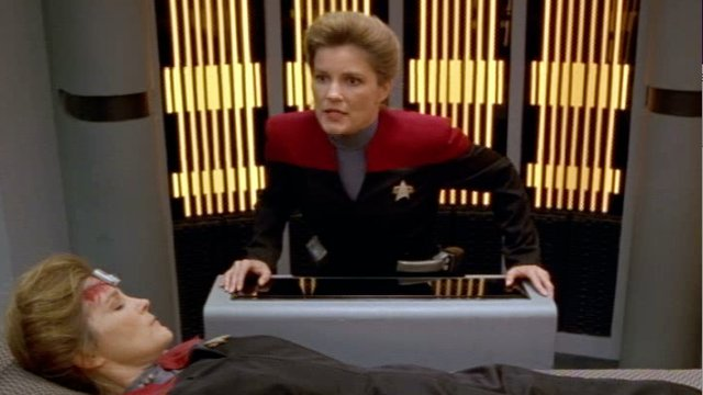 Janeway looks at herself, apparently dead in Sickbay