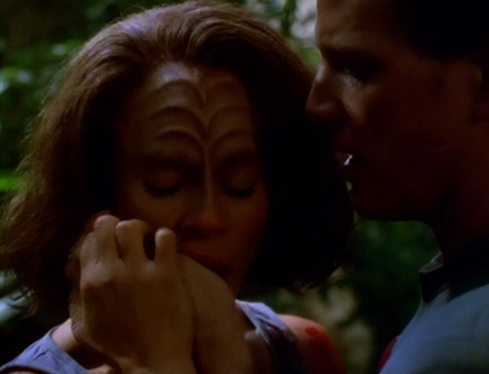 "Tom and B'Elanna embrace in ""Blood Fever"""