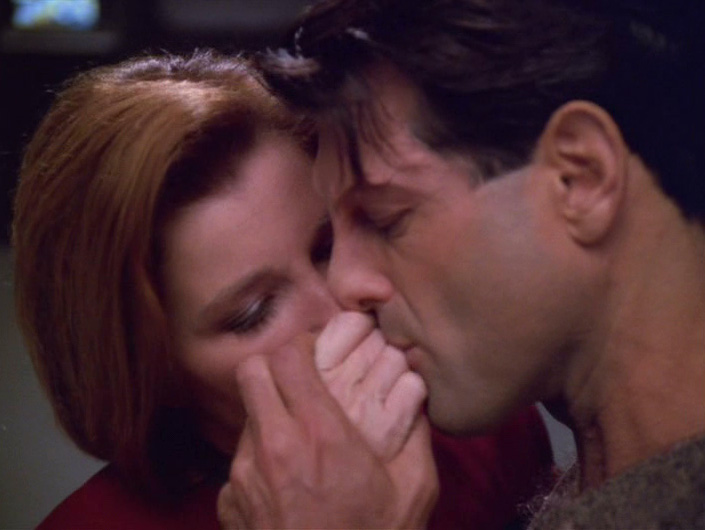 "Kashyk kisses Janeway's hand in ""Counterpoint"""