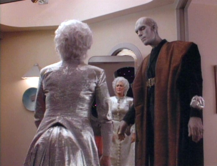 Lwaxana in silver-grey dress and white wig