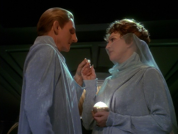 Lwaxana and Odo in their wedding outfits