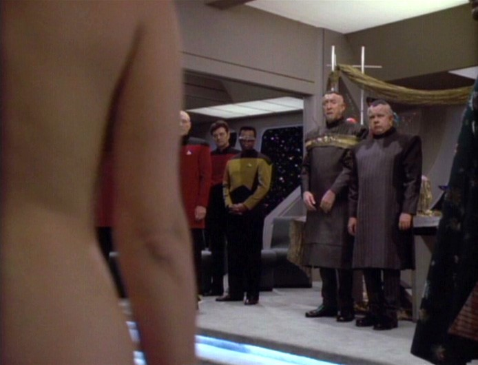 Lwaxana shocks dignitaries by appearing naked to her wedding