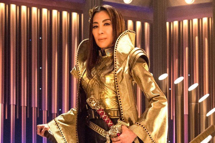 Mirror Georgiou posing in her gold Terran Emperor regalia