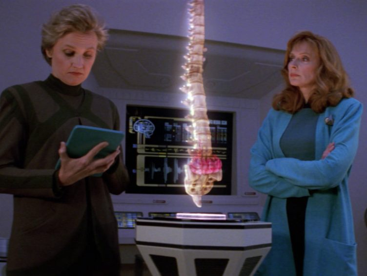 Crusher and Toby Russell debate Worf's treatment