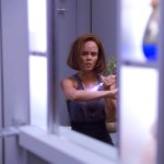 B'Elanna looks at herself in the mirror healing her injured arm