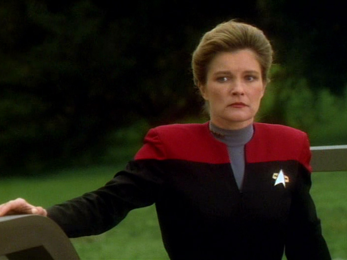 Janeway in her uniform about to leave the planet