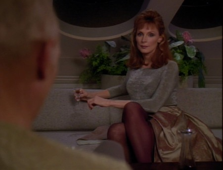 Doctor Crusher off-duty in a voluminous skirt and tights