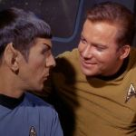 Spock and Kirk chatting, Kirk's arm around Spock