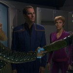 Tellarite and Andorian shake hands while Archer and T'Pol look on
